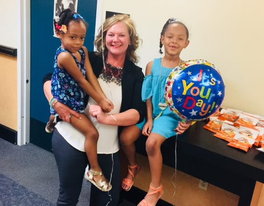 Director of the Washoe County Human Service Agency Amber Howell with two girls who were adopted on Aug. 17, 2018.