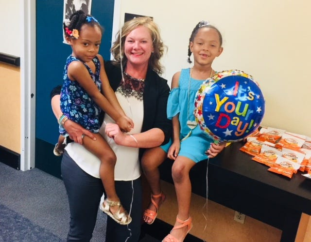 A family celebrates after an adoption is final at an Adoption Day put on the Washoe County Human Service Agency on Aug. 17, 2018.