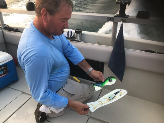 Veteran charter captain Jerry Felluca of Rebel Charters shows off the lure setup he planned to offer as breakfast to trout and salmon during the 25th annual Casting for Character sport fishing derby on Lake Ontario. Twenty-two boats competed out of the Port of Rochester Marina.