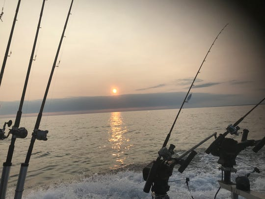Sunrise on Lake Ontario out of the Port of Rochester Marina, site of the 25th annual Casting for Character sport fishing derby to benefit Boys Scouts of America's Seneca Waterways Council.
