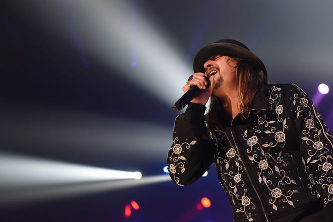 Kid Rock performs at Little Caesars Arena in Detroit on Tuesday night, Sept. 12, 2017. His appearance was met by dozens of protesters from a civil rights group.