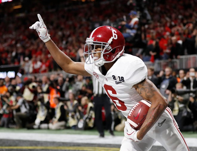 FILE - In this Jan. 8, 2018, file photo, Alabama wide receiver DeVonta Smith (6) celebrates his touchdown during overtime of the NCAA college football playoff championship game against Georgia, in Atlanta. The AP preseason Top 25 is out, and for the third straight year Alabama is No. 1.