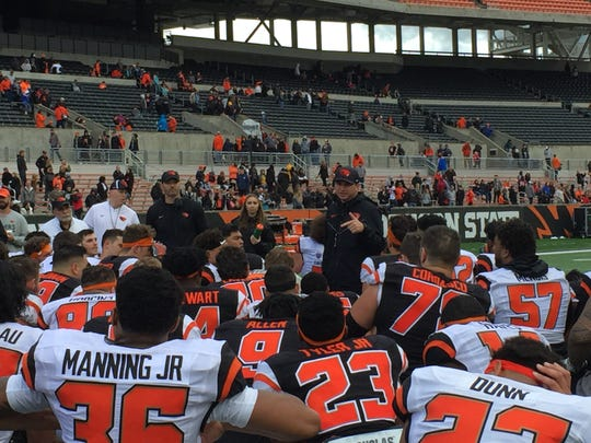 Oregon State players gather around head coach Jonathan Smith following the annual spring game at Reser Stadium, April 28, 2018.