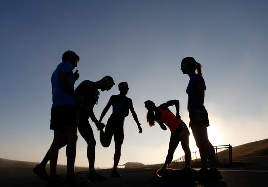 Half Marathon runners stretch before the Golden State Trail Run at Fort Old National Monument and Laguna Recreation Area in Monterey County, California on Saturday August 18, 2018.The event featured 10K, Half Marathon, 35K and 50K races. Photo By David Royal