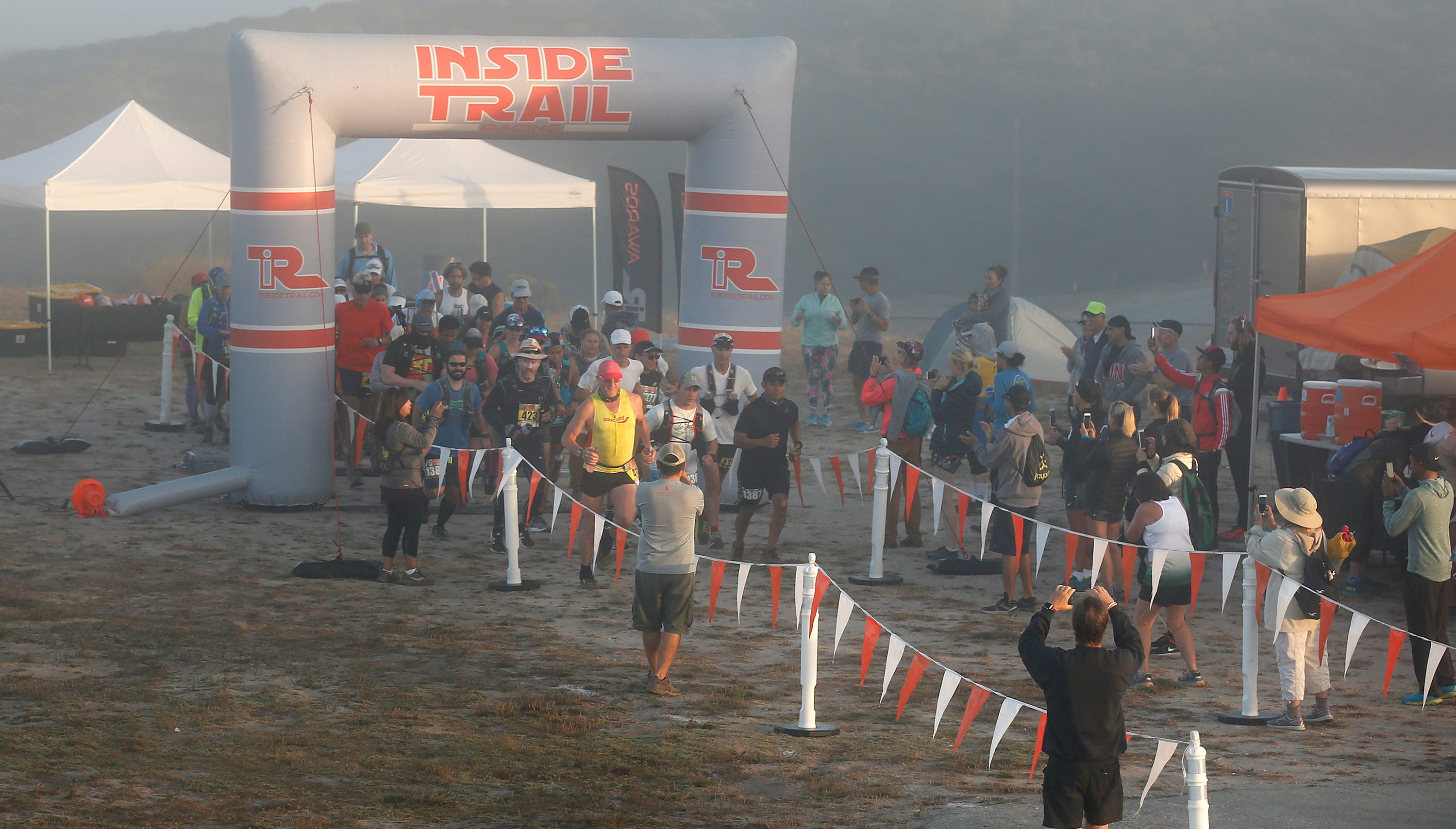 35K and 50K division runners start their race under foggy conditions during the Golden State Trail Run at Fort Old National Monument and Laguna Recreation Area in Monterey County, California on Saturday August 18, 2018.The event featured 10K Half Marathon, 35K and 50K races. Photo By David Royal