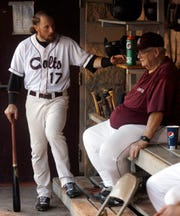 San Angelo Colts second baseman Jon Dziomba chats with the Colts manager Doc Edwards during a game in 2013.