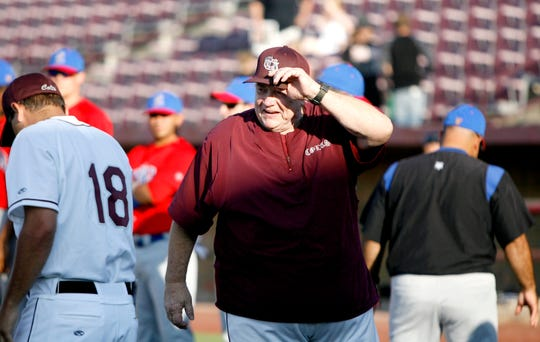 San Angelo Colts manager Doc Edwards heads back to the dugout after shaking hands with the Amarillo Dillas manager in the opening game of the Colts season at Foster Field in May 2010.