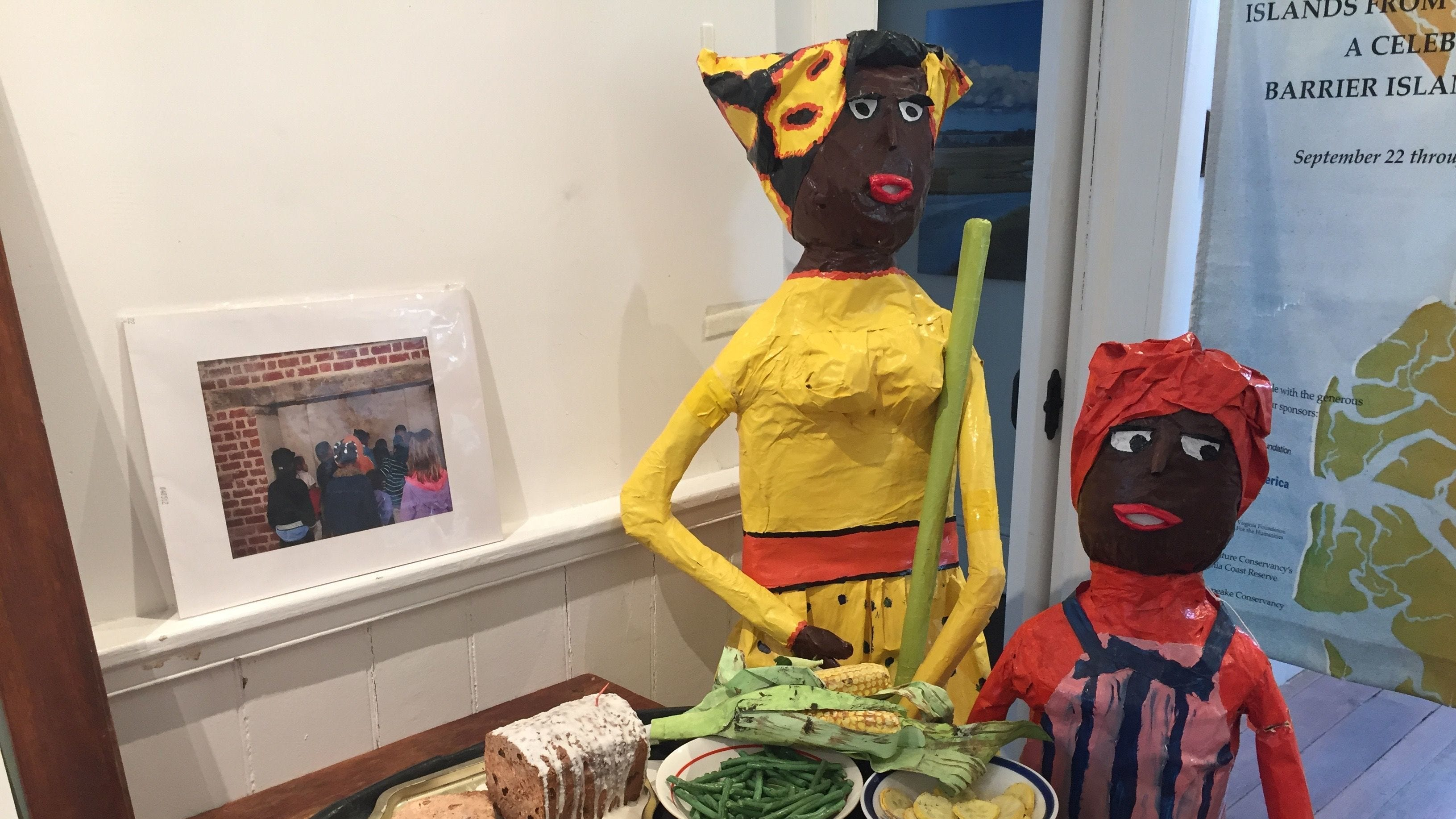 Elements of a traditional Hog Island picnic, along with sculptures made by folk artist Mama Girl, on display at the Barrier Islands Center in Machipongo.