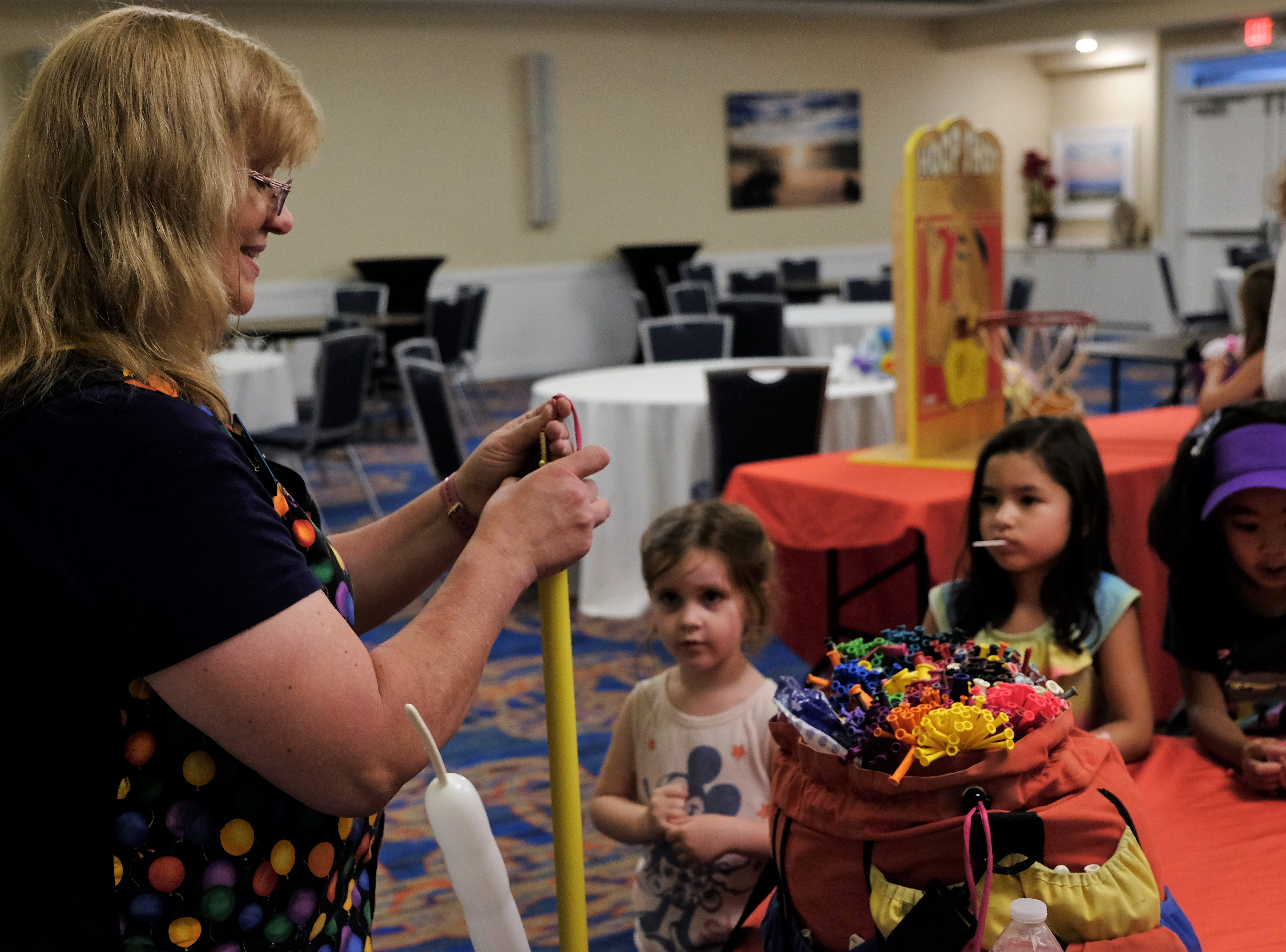 Renate McIntosh had a long line on Aug. 15 at Bethany Beach Ocean Suites, as kids waited for their imaginations to come to life in balloon form.