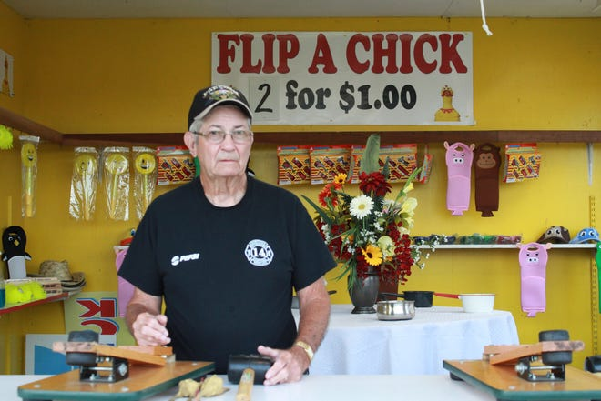 George White is one of the dozens of community members who volunteer their time at the Sharptown Firemen's Carnival. White now spends his time working the carnival's 'flip-a-chic- booth, where he can watch his community enjoy the games and rides.