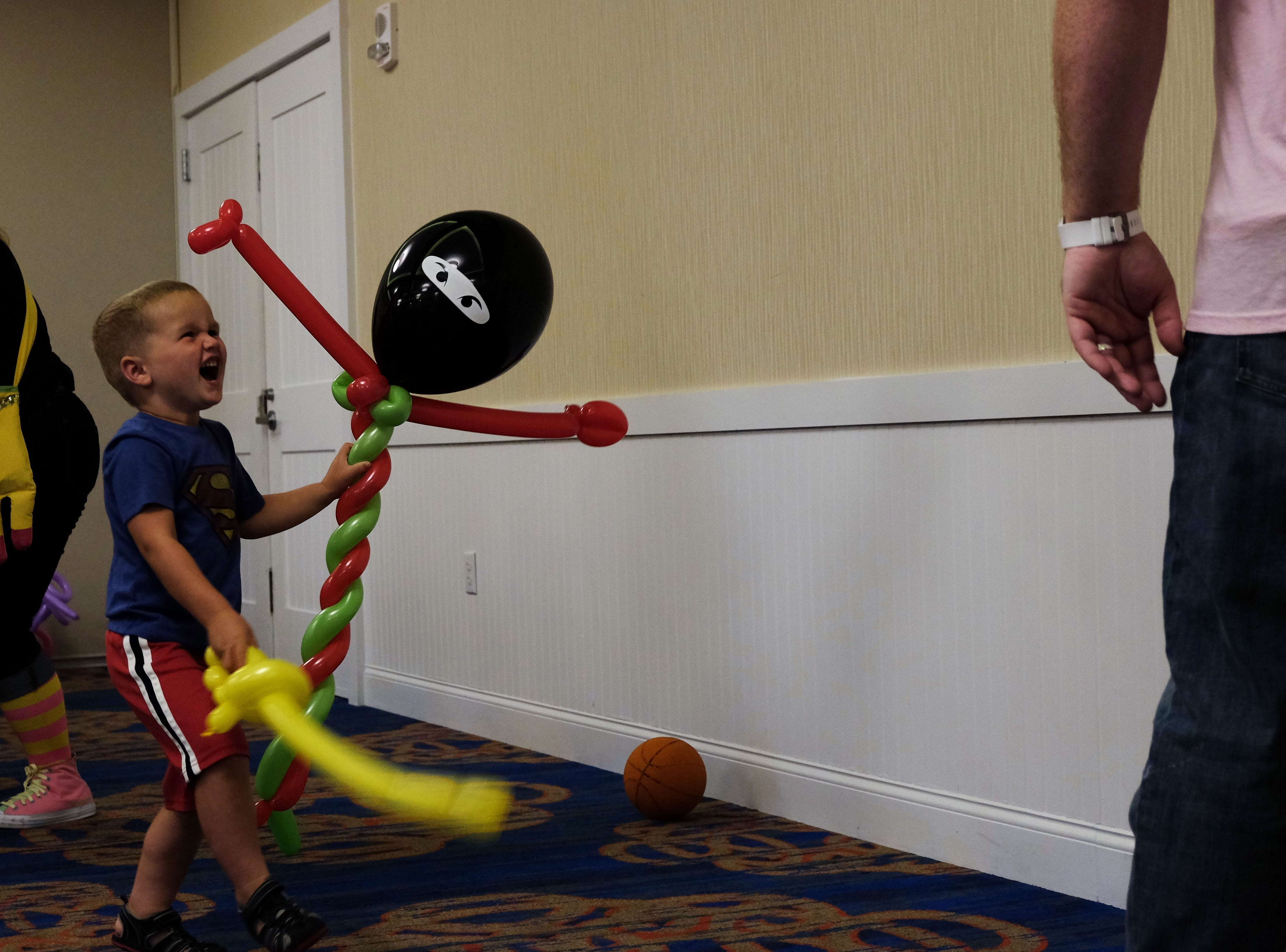 A boy uses ninja powers to fight off the bad guys on Aug. 15 at Bethany Beach Ocean Suites, where Renate McIntosh showed off her balloon skills.