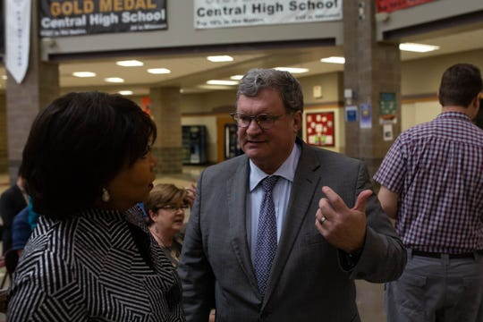 Cheryl Brown Henderson speaks with Drury University President Tim Cloyd at Sunday's celebration of Rev. Oliver Brown at Central High School.
