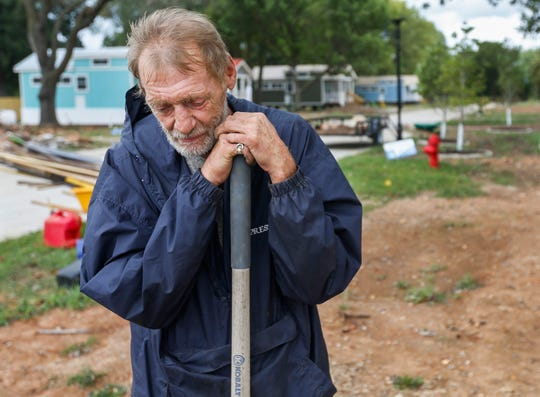 """Tommy Yarberry leans on his shovel while taking a break from volunteering at Eden Village on Tuesday, Aug. 14, 2018. Yarberry, who has been homeless for three years, will be the first resident to move into the new community. Yarberry said, """"I can never give back what they gave me."""""""