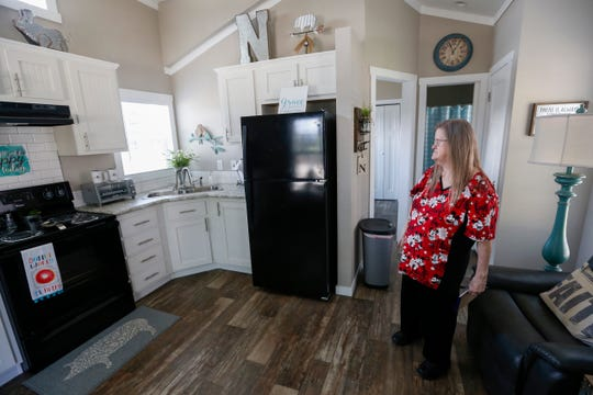 Nancy Lawrence looks at the kitchen inside her future home at Eden Village on Thursday, Aug. 16, 2018. Lawrence, who is deaf and lived in her car for years, will be the second person to move into the new community.