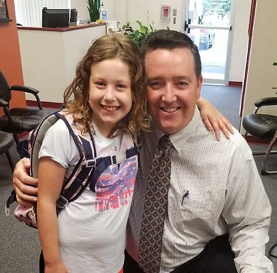 Matt Pearce, assistant superintendent of the Republic school district, poses for a photo with his daughter, Audrey, 8. She required a heart transplant as a baby.