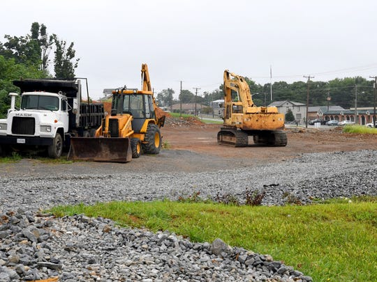 Construction equipment occupies land between Community Way and Bell Street, located below Big Sky Apartments, is being developed commercially into a retail strip mall along Richmond Avenue. Photo taken on Monday, August 20, 2018.