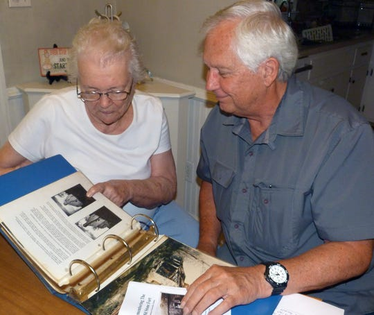 Lillian Peters and Don Houser go over some of Lillian's historic material recently while putting together the story of the frontier building.
