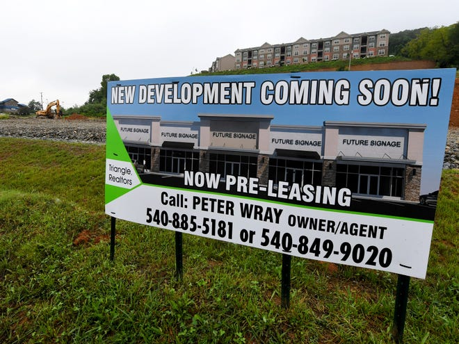 A sign facing Richmond Avenue marks land between Community Way and Bell Street, located below Big Sky Apartments, as being developed commercially into a retail strip mall on Monday, August 20, 2018.