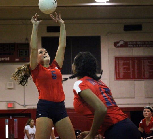 Wakulla's Melanie Oglesby sets a ball for during Saturday's preseason classic at Leon.