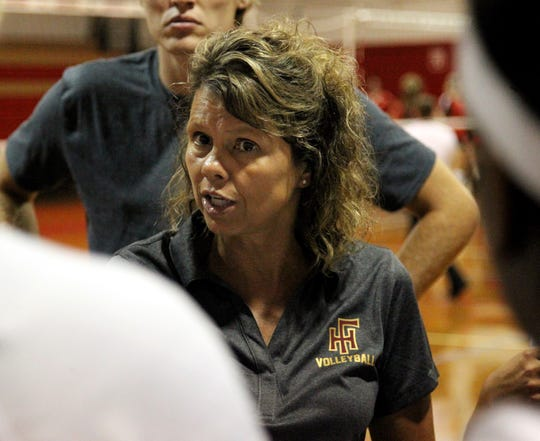 New Florida High volleyball coach Sheila Roberts talks to her team during a timeout at Saturday's preseason classic at Leon.