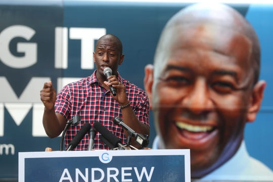 Gubernatorial candidate Andrew Gillum speaks to supporters as he kicks off his statewide bus tour with a rally at Kleman Plaza on Monday, Aug. 20, 2018.