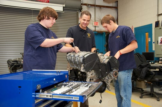 Chipola Automotive Instructor (center) works with students