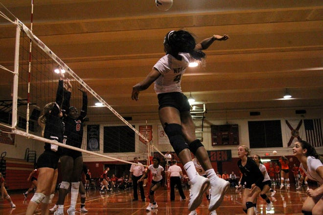 Florida High's Jada Rhodes goes up for a kill during a preseason match against Leon on Saturday.