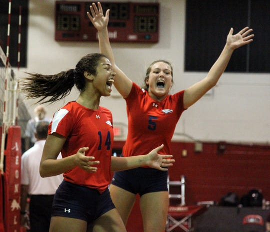 """Wakulla's Tanasha """"Baby"""" Cooksey celebrates a point with Melanie Oglesby during a preseason match Saturday at Leon."""