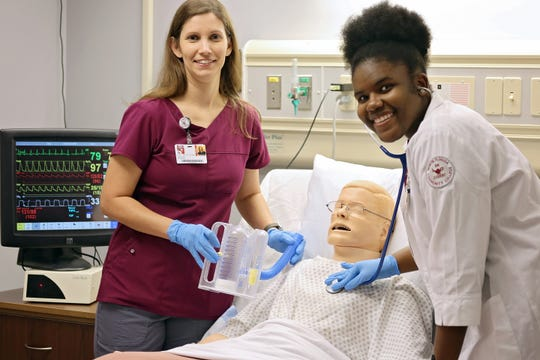 North Florida Community College student Monica Powe, right, works through an active simulation scenario with NFCC RN instructor Sharon McClune in the college's Allied Health simulation lab.