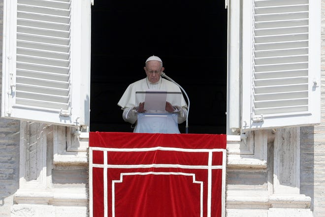 """In this Aug. 19, 2018 file photo, Pope Francis prays for the victims of the Kerala floods during the Angelus noon prayer in St.Peter's Square, at the Vatican. Pope Francis has issued a letter to Catholics around the world condemning the """"crime"""" of priestly sexual abuse and cover-up and demanding accountability, in response to new revelations in the United States of decades of misconduct by the Catholic Church."""