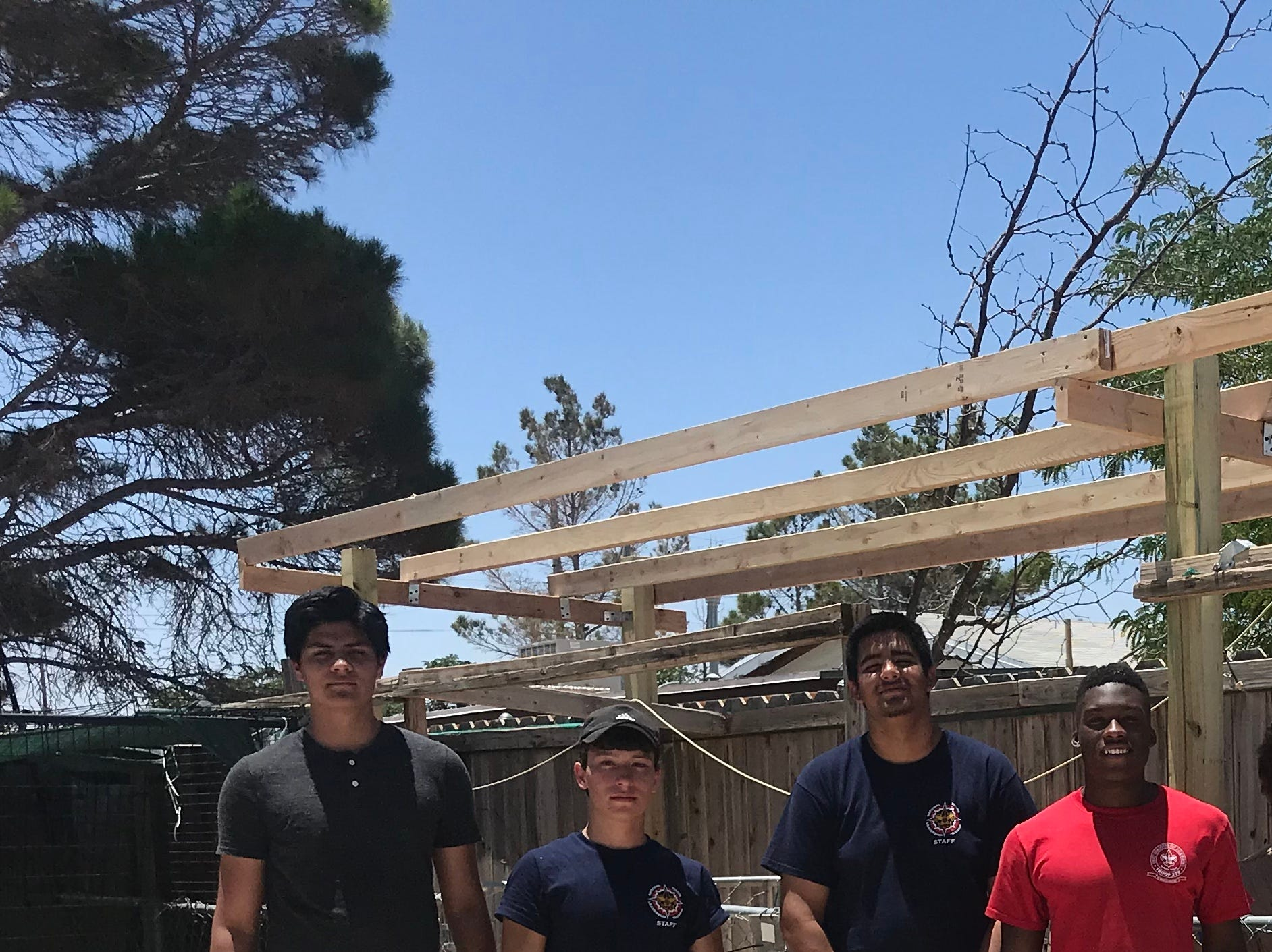 James Cordero, second from left, with friends from his troop and school who helped with the Eagle project.