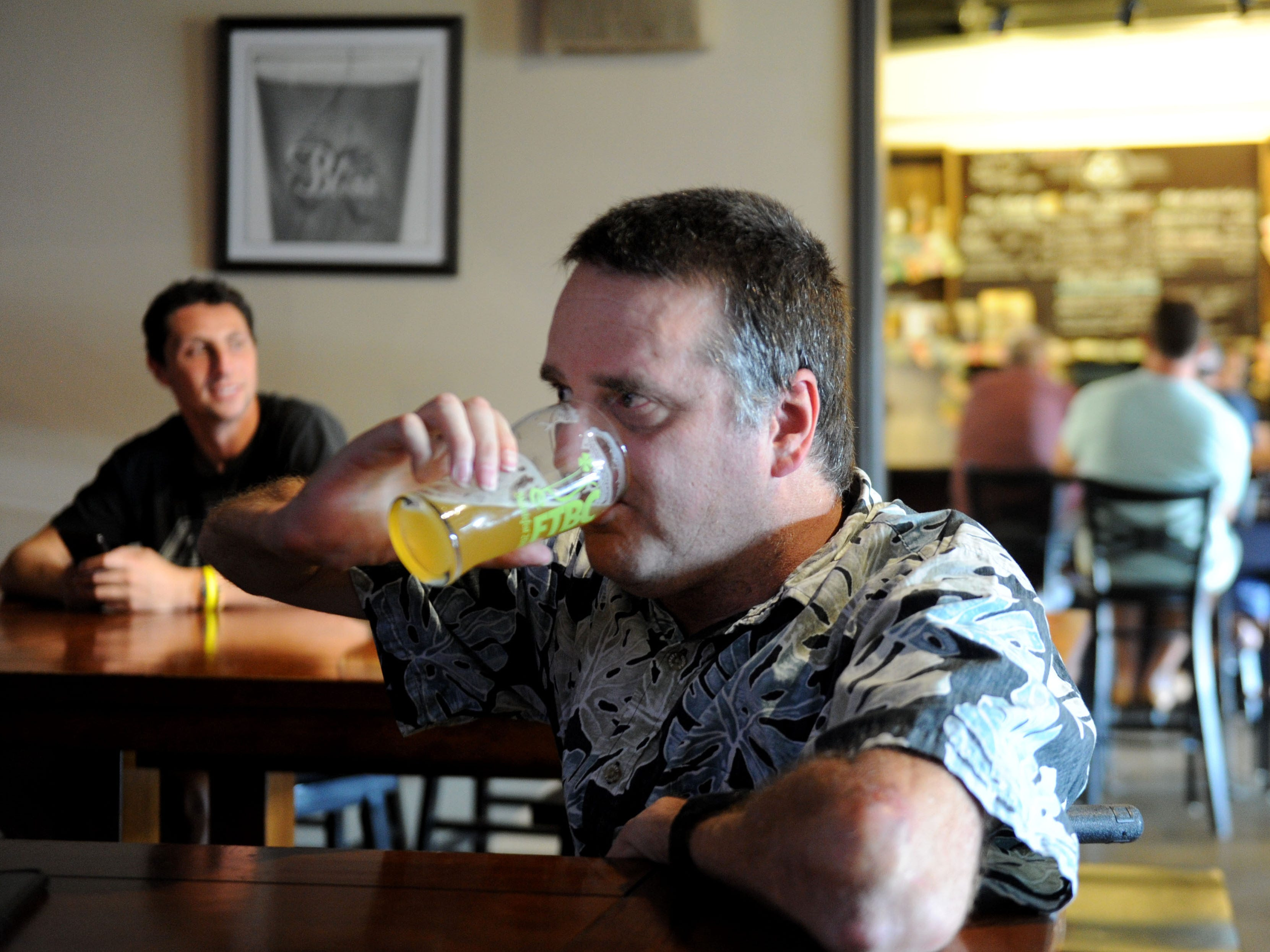 Chris Flynn enjoys a beer at Five Threads Brewing Company in Westlake Village. He visited the brewery on the day it opened and has become a regular.