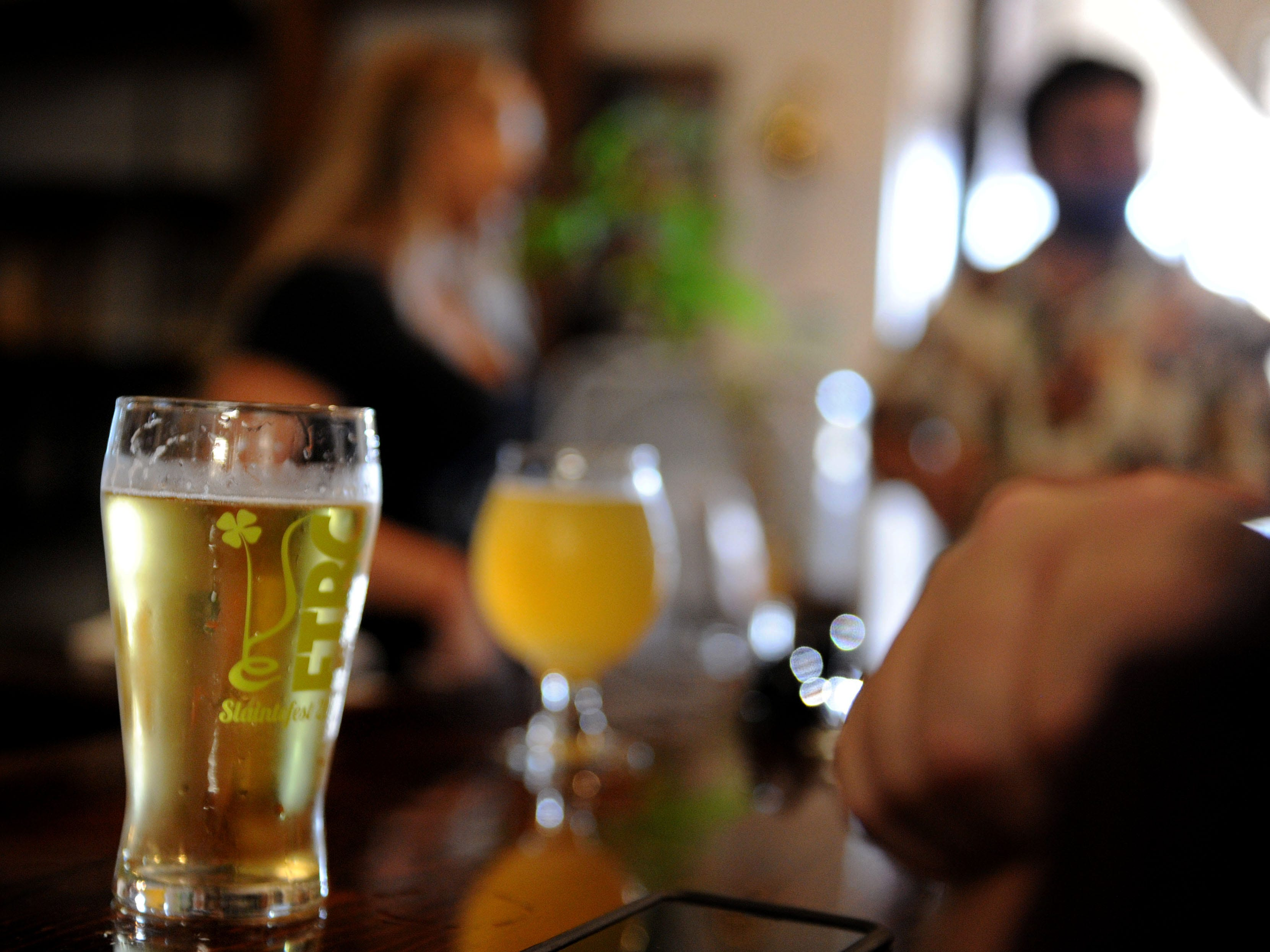 Customers enjoy an afternoon beer at Five Threads Brewing Company in Westlake Village. The company was founded by Tim Kazules, who took up brewing after a career in the bioscience industry.