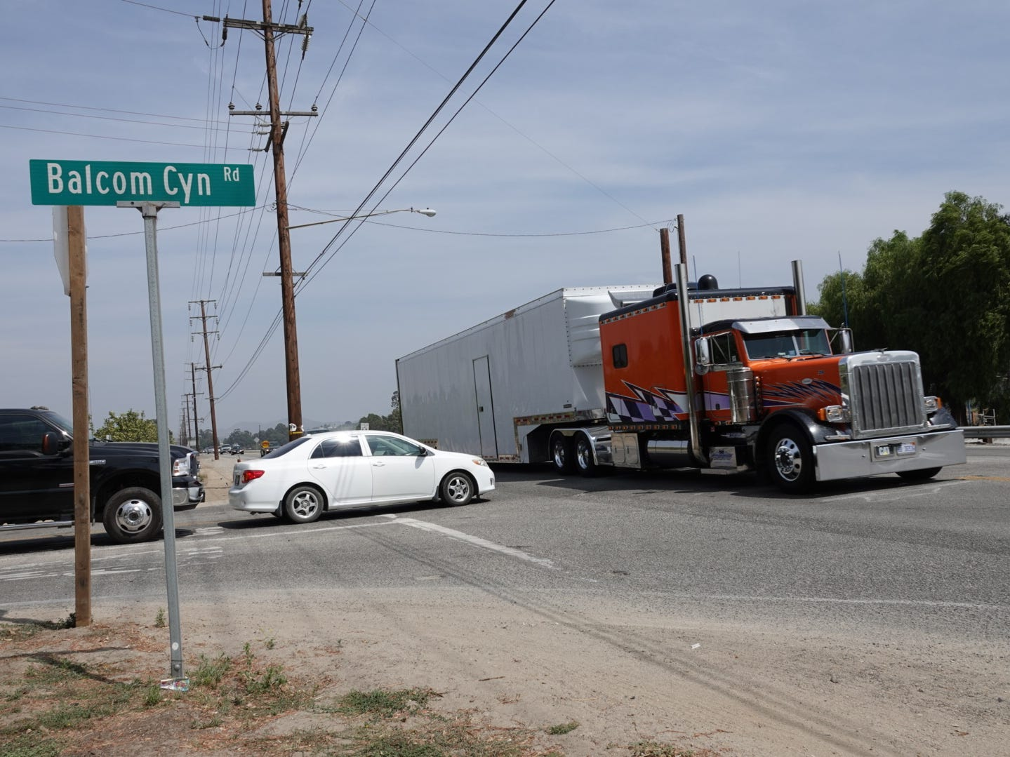 A big-rig honked a warning Monday afternoon as a white sedan tried to turn left onto Highway 118 from Balcom Canyon Road. A fatal crash at the intersection Aug. 10 came after planned construction of a signal was delayed.