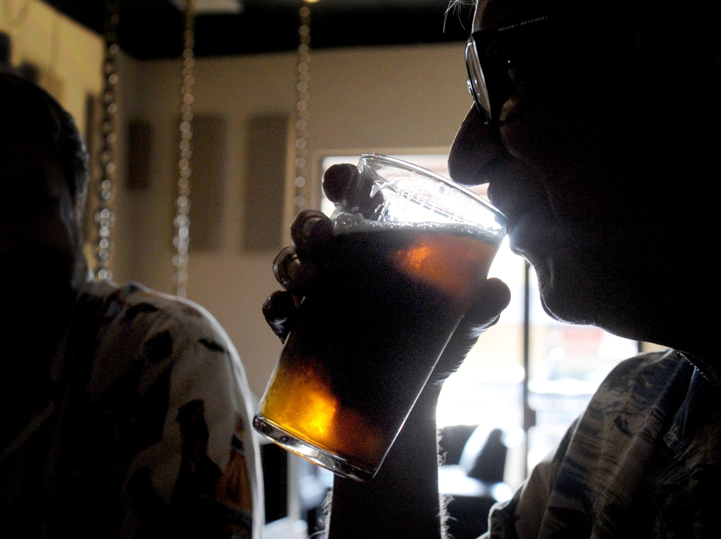 Lynn Robison drinks a beer at Five Threads Brewing Company in Westlake Village.