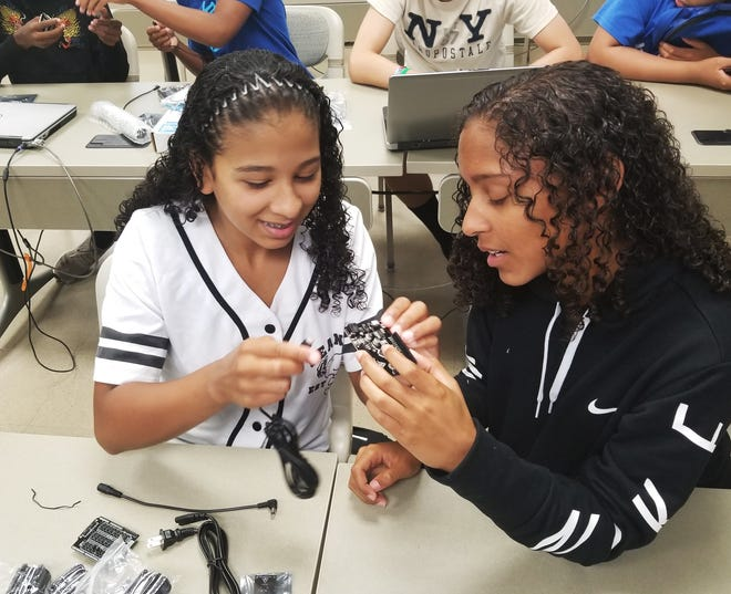 Carver Early College High School students from Cumberland Regional High School use coding and mechanical engineering to learn how robots can help solve problems in health care, logistics, and more during the 2018 Carver Summer Bridge program at Cumberland County College in Vineland.