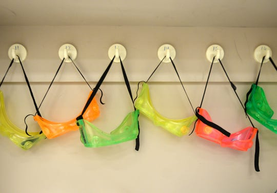 Colorful goggles hang on the wall in a AMSA Academy science classroom at the former Johnstone Elementary School in Vineland on Monday, August 20.