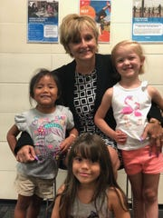 Theresa Booth, senior director of Child Development of the Cumberland Cape Atlantic YMCA, recently earned certification as Praesidium Guardian. She is pictured with some children at the YMCA.