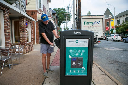 Former Newark Mayor Vance A. Funk III cleans Main Street at 7 a.m. on Monday, August 20.
