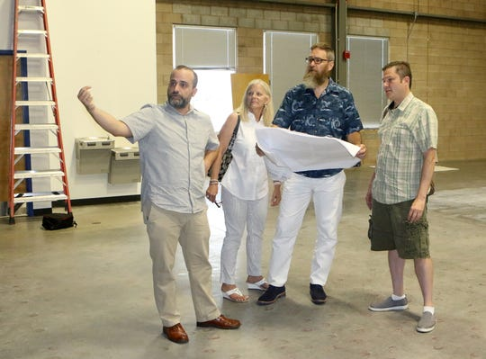Jeff DiRomaldo, Meg Etherington, Brian Moores and Phil Nannay discuss plans for the new venue, which will have both escape rooms   and a hatchet-throwing area.