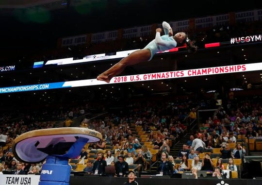 Simone Biles warms up on the vault at the U.S. Gymnastics Championships, Sunday, Aug. 19, 2018, in Boston.