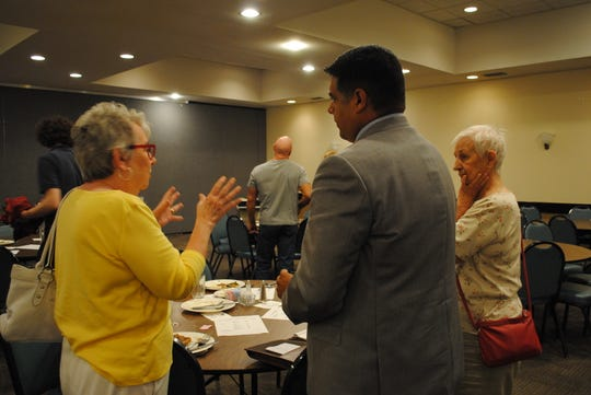 Wichita Falls Mayor Stephen Santellana answers questions Monday from members of the Wichita County Republican Women. He gave a state-of-the-city speech to the group during their meeting at Luby's Cafeteria.