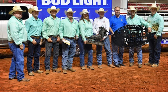 Members of the Bonds Ranch in Saginaw receive their awards and gate sign as the Winning Team Saturday night at the Texas Ranch Roundup at the Kay Yeager Coliseum. This year's  Top Hand was Colten Mayo of the Burns Ranch.