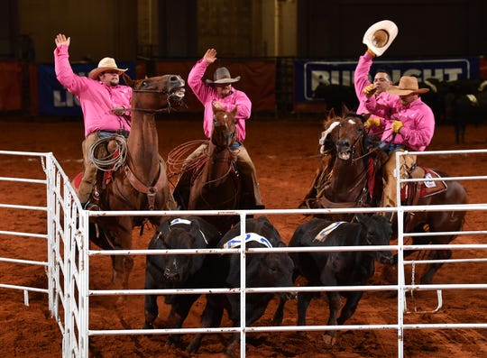 Members of the Rocker b Ranch successfully pen their calves during the Team Penning competition Saturday night at the Texas Ranch Roundup at the Kay Yeager Coliseum. This year's Winning Team was the Bonds Ranch and the Top Hand was Colten Mayo of the Burns Ranch.