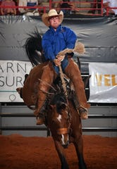 Logan Daniel of the RA Brown Ranch rode Pocket Change to a score of 85 to lead the Bronc Riding Saturday night at the Texas Ranch Roundup at the Kay Yeager Coliseum. This year's Winning Team was the Bonds Ranch and the Top Hand was Colten Mayo of the Burns Ranch.
