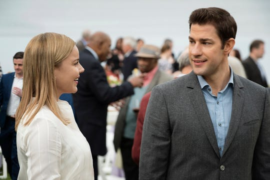 Before getting called away to work, Jack Ryan (John Krasinski) meets Cathy Muller (Abbie Cornish), a doctor who specializes in infectious diseases.