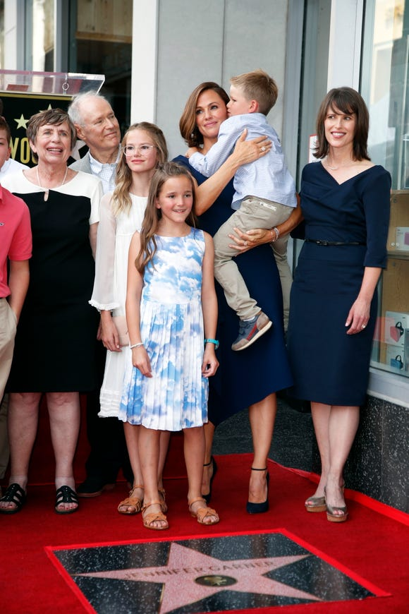 Jennifer Garner held son Samuel, 6, while posing with daughters Violet, left, and Seraphina.
