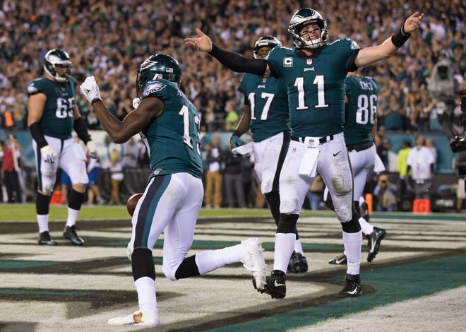 Oct 23, 2017; Philadelphia, PA, USA; Philadelphia Eagles wide receiver Nelson Agholor (13) celebrates with quarterback Carson Wentz (11) after his touchdown catch during the fourth quarter against the Washington Redskins at Lincoln Financial Field. Mandatory Credit: Bill Streicher-USA TODAY Sports