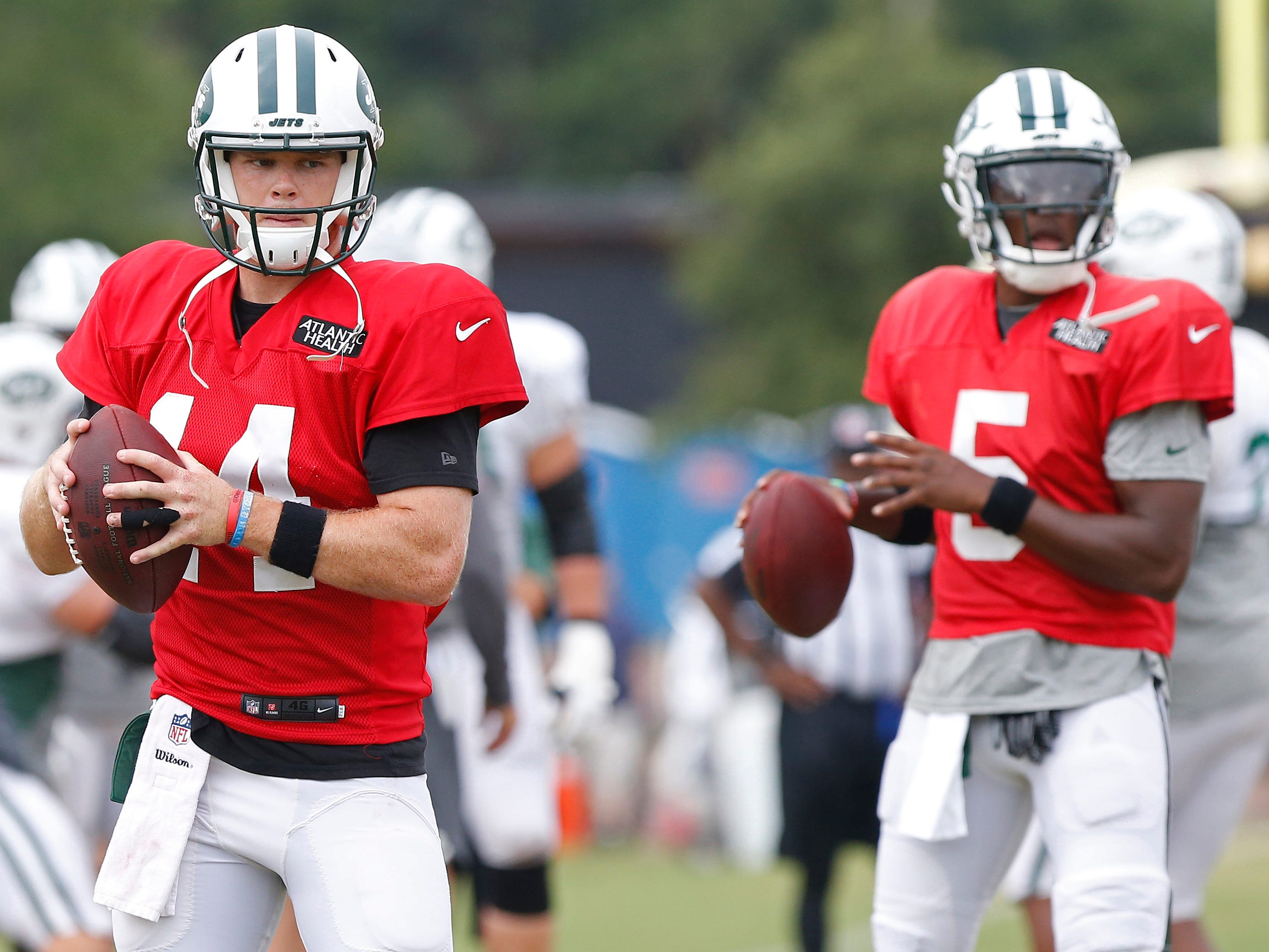 New York Jets quarterback Sam Darnold (14) and New York Jets quarterback Teddy Bridgewater (5) participate in drills during a joint practice with the Washington Redskins at Bon Secours Washington Redskins Training Center.