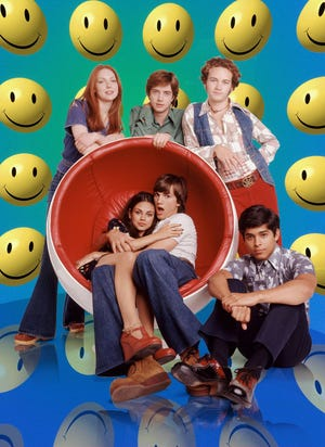 """That '70s Show,"" which made its debut 20 years ago, followed a group of friends navigating teenage life in Wisconsin. The show, featuring Laura Prepon, Topher Grace, Danny Masterson, Wilmer Valderrama, Ashton Kutcher, and Mila Kunis, lasted for eight seasons before being canceled by Fox in 2006."